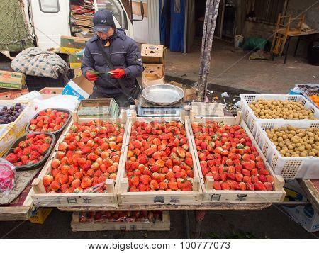 Street Fruit Seller On Street Market In China.