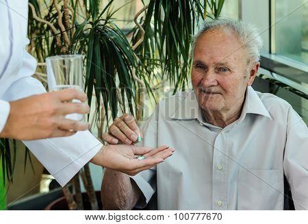 Elderly Man Takes Medication