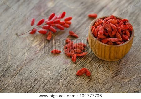 Barberries And Goji Berries Isolated On Wooden Background