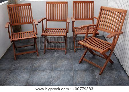 Four Folding Wooden Chairs