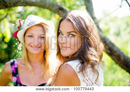 Happy women smiling in sunny summer park