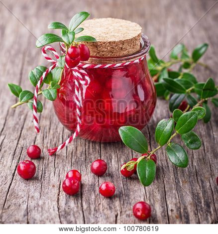 Homemade cranberry sauce in a small jar