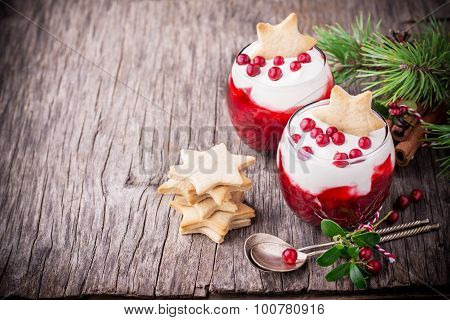 Festive dessert with cranberry sauce, sour cream and ginger biscuits