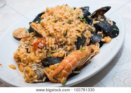 A Dish Of  Seafood Rice Pics, With Mussels, Clams, Shrimp, Mussels.