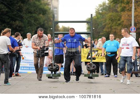 Orel, Russia, September 5, 2015: Man Powerlifter Carries Heavy Weight On His Shoulders In Competitio