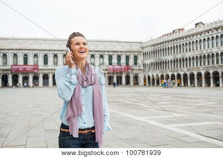 Woman Tourist Laughing On Mobile In St. Mark's Square
