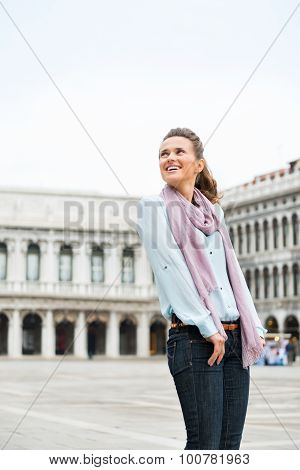 Smiling Woman Looking Over Shoulder On St. Mark's Square, Venice