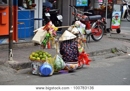 Unidentified Street Vendor On Street In Saigon Vietnam
