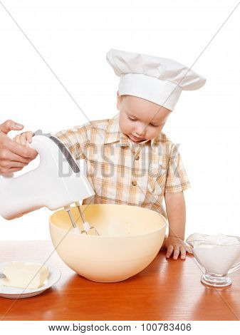 Mother And Son Preparing Cake On A White Background