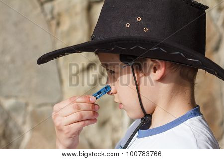 Boy Wearing A Cowboy Hat Looks Ridiculous With Clothespin
