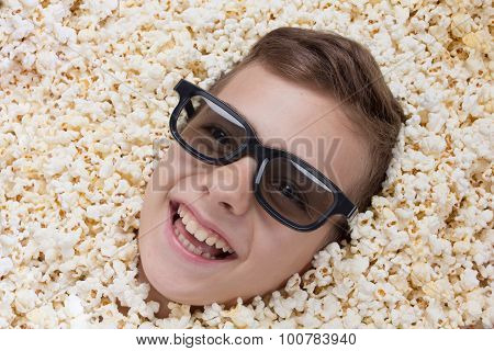 Laughing Young Boy In Stereo Glasses Looking Out Of Popcorn
