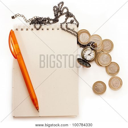 A spiral notebook with a place for text, a pen, a chain watch and some euros on white background