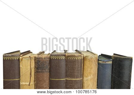 Front view of old books stacked on a shelf. Books without title and author.