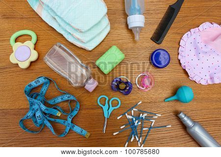 Baby accessories: pacifier, bottle, disposable diapers, scissors, funds for the bath, meter to measu