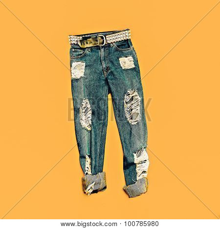 Torn Fashion Blue Jeans On Yellow Background