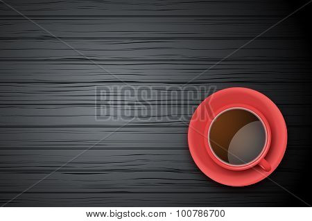 Red Cup of coffee or tea on the table dark wood