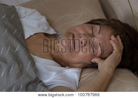 Senior Woman Having Difficulty Falling Asleep At Nighttime