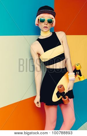 Fashion Model With Skateboard On Bright Exclusive Background