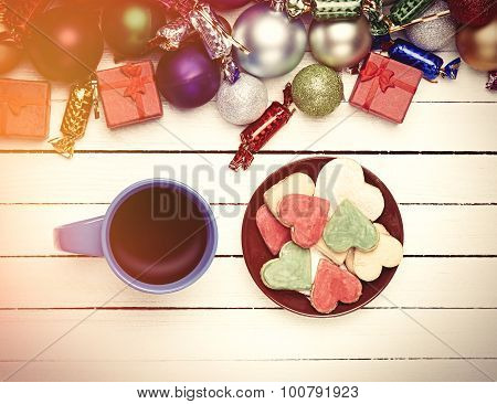 Cup Of Coffee And Cookie With Christmas Toys On Whte Background.