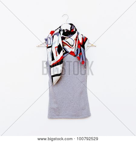 T-shirt On Hanger With Bright Scarf. Fashion Clothing