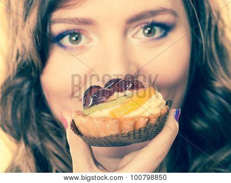 Closeup Woman Face And Fruit Cake
