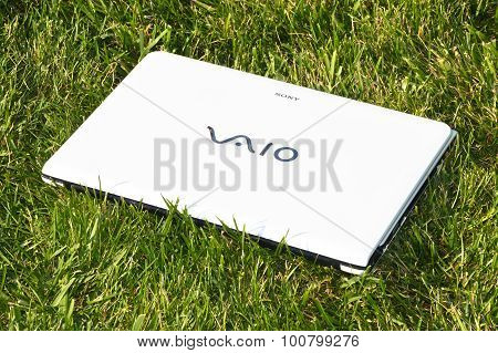 White Sony Vaio laptop on the grass