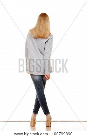 Woman In Denim Pants High Gray Shirt Back View