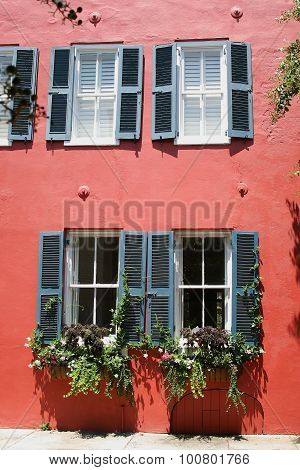 French shutters with stucco wall