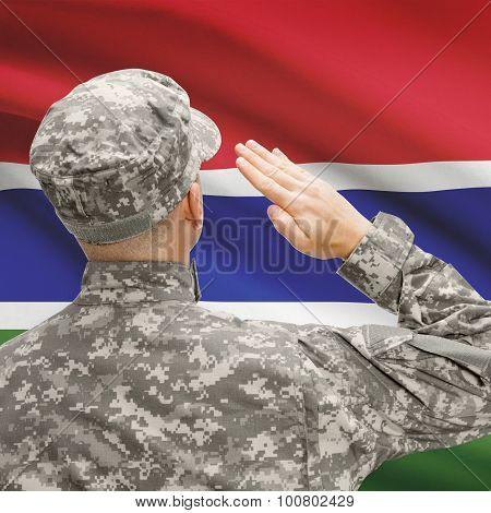 Soldier In Hat Facing National Flag Series - Gambia