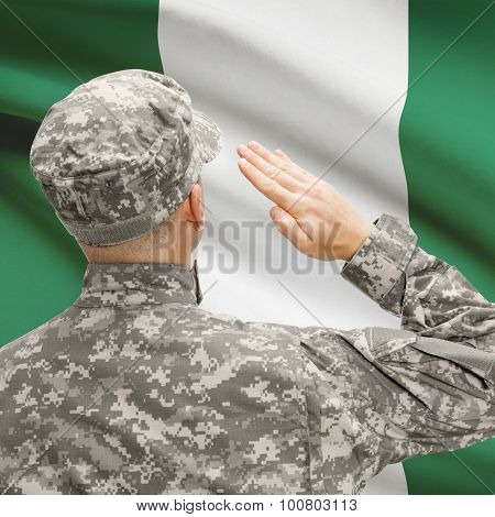 Soldier In Hat Facing National Flag Series - Nigeria