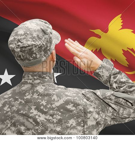 Soldier In Hat Facing National Flag Series - Papua New Guinea