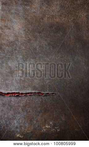 vertical metal bacground with horizontal crack or cut