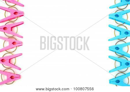 Lots Of Clothespins On A White Background With Copy Space