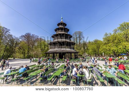 People Enjoy The  Biergarten Near Chinese Tower