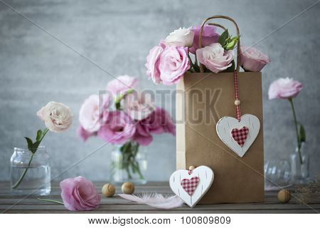 Wedding vintage background with pink flowers feathers and hearts