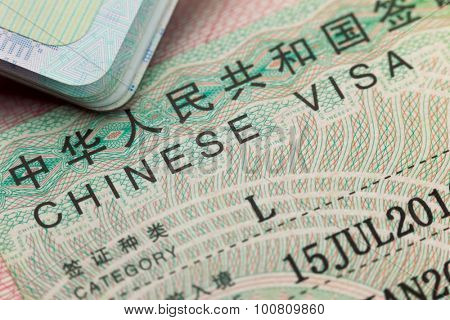 Chinese visa in a passport - enjoy travel background
