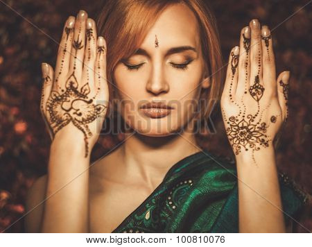Woman with traditional mehndi henna ornament