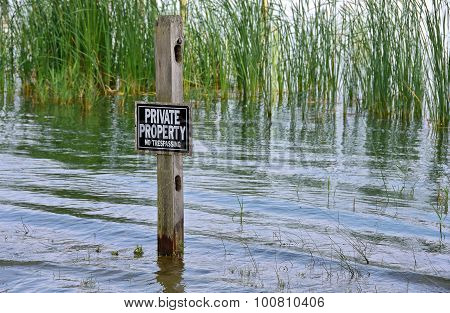 private property sign in wetland
