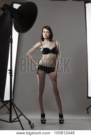 Image of leggy girl posing in studio photography
