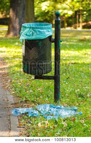 Trash Can In Park And Heap Of Plastic Bottles, Littering Of Environmental