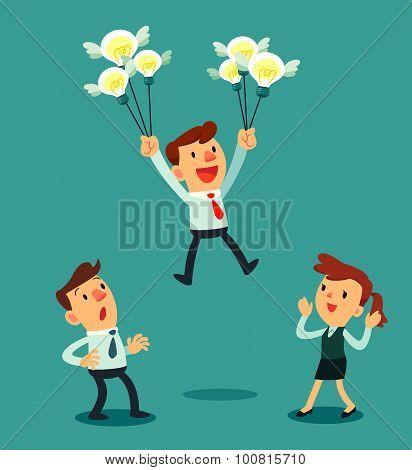 Businessman Holding A Group Of Idea Bulbs