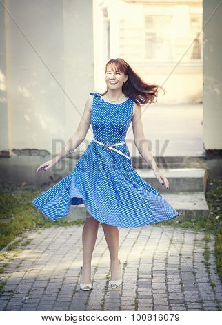 Beautiful Woman In Retro Style Dress Whirl