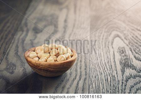 peeled hazelnuts in wooden bowl