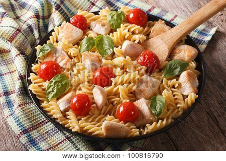 Homemade Pasta Fusilli With Chicken, Cherry Tomatoes And Basil Closeup