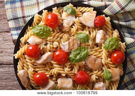 Fusilli Pasta With Chicken, Tomatoes And Basil Closeup. Horizontal Top View