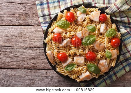 Fusilli Pasta With Chicken, Tomatoes And Basil On Plate. Horizontal Top View