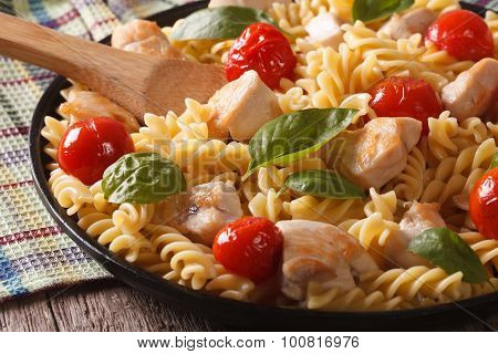 Fusilli Pasta With Chicken And Tomatoes Close-up. Horizontal