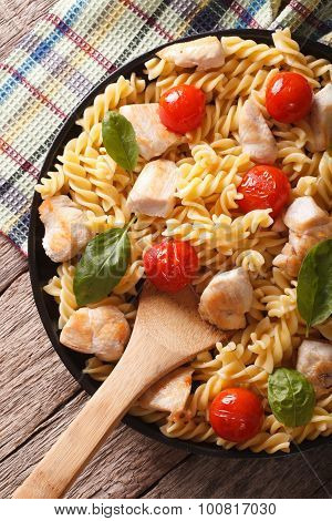 Fusilli Pasta With Chicken And Tomatoes Closeup. Vertical Top View