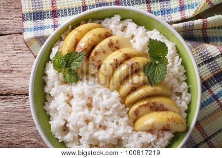 Rice With Caramelized Apples In A Bowl Close-up. Horizontal Top View