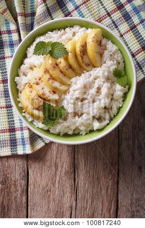 Rice With Caramelized Apples In A Bowl. Vertical Top View